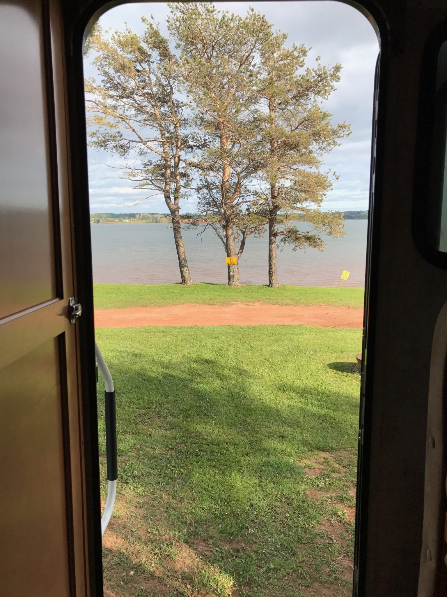 Truckcamper door with a view. KOA Cornwall, Prince Edward Island.
